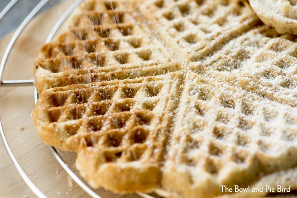 Warm waffles with icing sugar