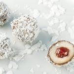 Coconut Bliss Ball cut open with jam center